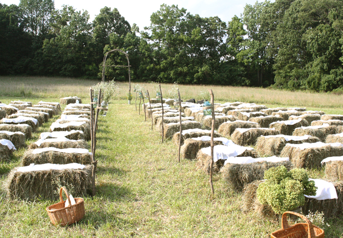 hay bale seating for an outdoor wedding