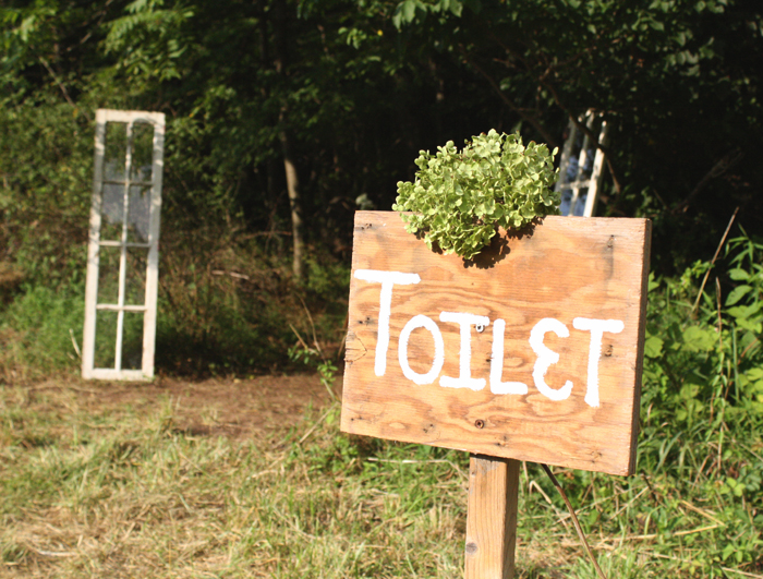 outdoor wedding restroom sign