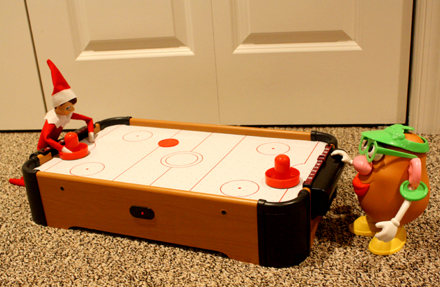 Elf on the Shelf: air hockey