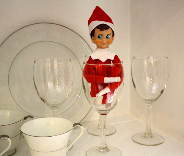 Elf on the Shelf: china cabinet