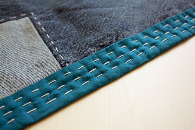 denim quilt with hand-stitched binding