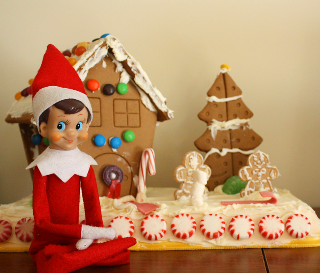 Elf on the Shelf with the gingerbread house