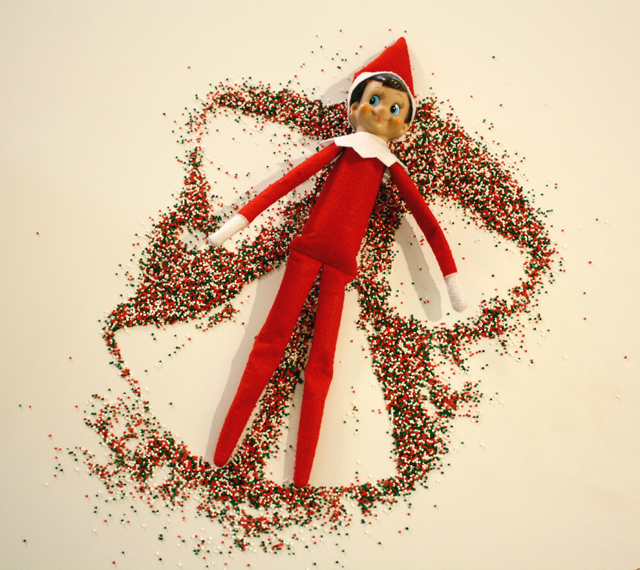 Elf on the Shelf makes snow angels in nonpareils