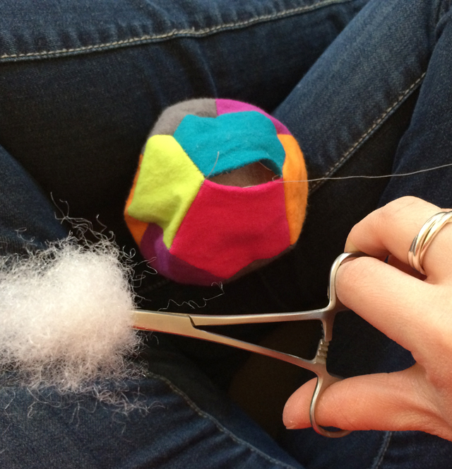 stuffing a patchwork ball made with English paper piecing