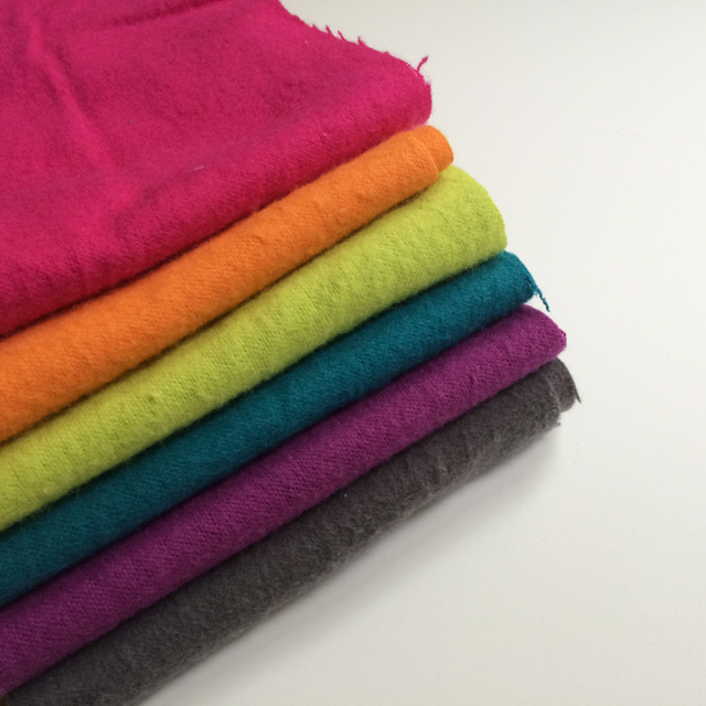 stack of brightly-colored flannel